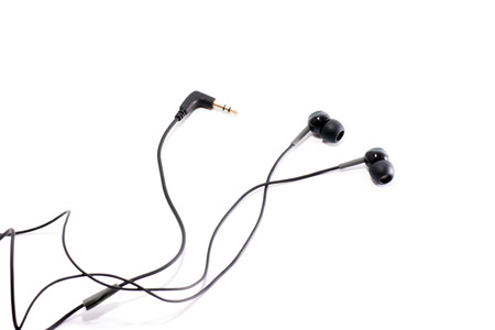 black earphones on a white background photo