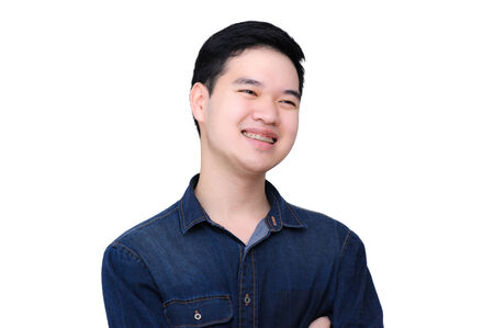 Portrait of happy asian man wearing jeans shirt, close up shot on white background. photo