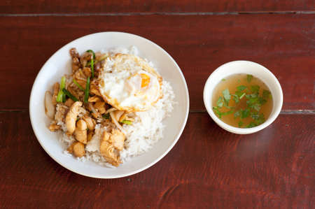 Fried sweet peper with pork meat with soup on wooden background. Thai food. photo