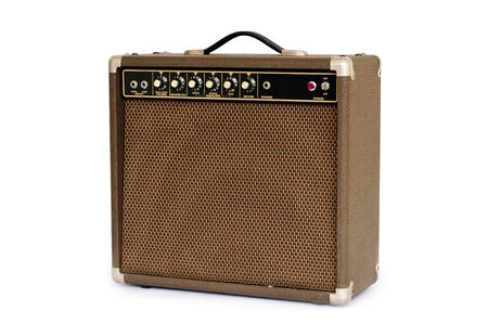 Brown electric guitar amplifier isolated on white background photo