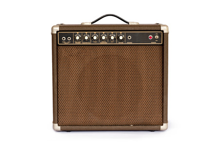 Brown electric guitar amplifier isolated on white background 스톡 콘텐츠