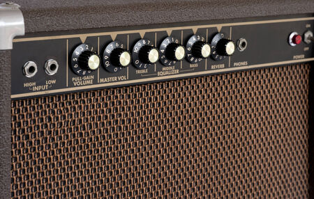 Close up of brown electric guitar amplifier photo
