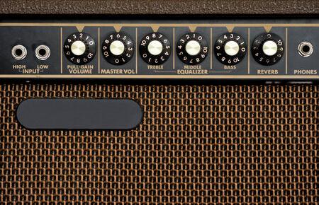 guitar amplifier: Close up of brown electric guitar amplifier