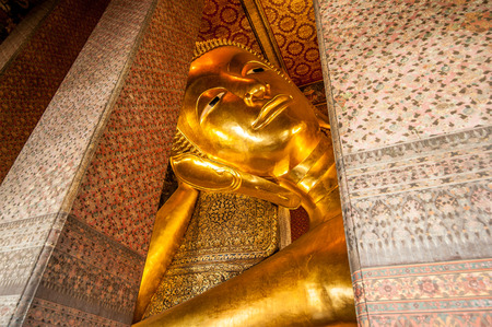 Reclining Buddha gold statue face. Wat Pho, Bangkok, Thailand
