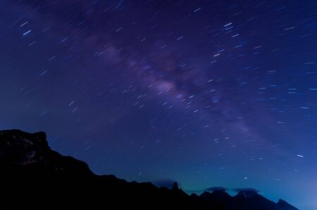 Milky Way Galaxy and Star Trails in Night Sky from Khao Sam Roi Yod National Park, Thailand photo