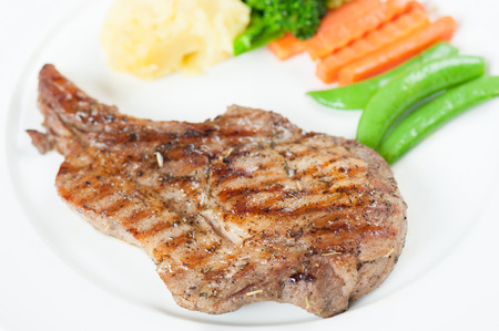 steak beef: Grilled Pork Steak with Boiled Vegetables Isolated on a White Background Stock Photo