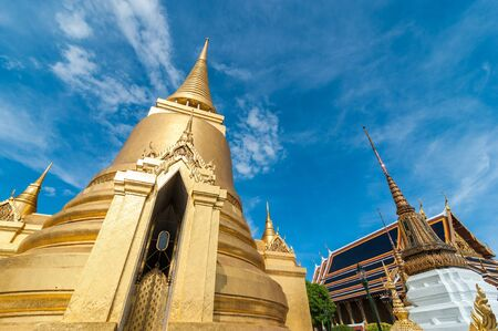 single story: Front of Gold Pagoda in Wat Phra Kaew, Temple of the Emerald Buddha with blue sky Bangkok,Thailand Stock Photo