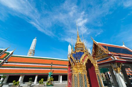 single story: Wat Phra Kaew, Temple of the Emerald Buddha with blue sky Bangkok,Thailand Stock Photo