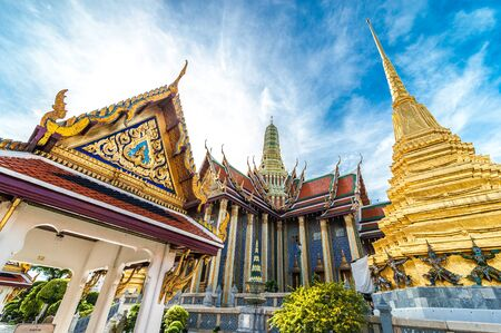 buddhist temple: Wat Phra Kaew, Temple of the Emerald Buddha with blue sky Bangkok,Thailand Stock Photo
