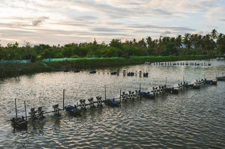 aerator: Aerator turbine wheel oxygen fill ins Into lake water. Shrimp farm, Thailand