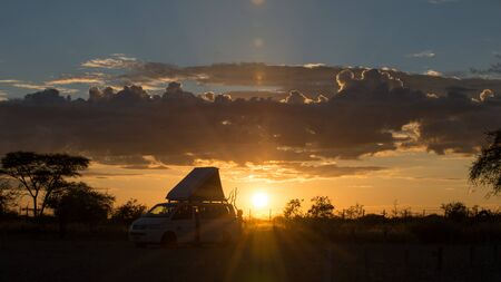 ETOSHA, NAMIBIA - APRIL 9, 2017: Car camp at sunrise in Okaukuejo Rest Camp. Okaukuejo is located 17 km from the southern entrance of the Etosha park, and famous for its flood-lit waterhole Editöryel