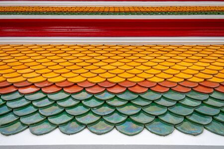 The roof of the temple made of color brick tiles is an ancient style with a diamond roof pattern which cannot be seen today Located in Bangkok, Thailand