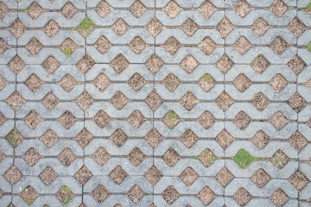 top view tiles with green grass in the garden texture Stock Photo
