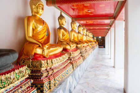 Blur focus nice Gold Buddha Statue at Wat Pho temple, bangkok, Thailand