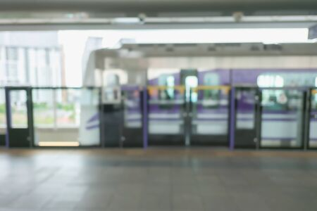 Blurred background of skytrain platform with copy space in transportation concept.
