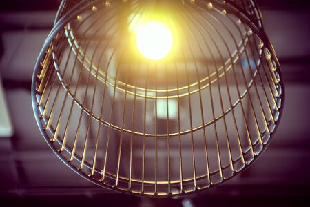 Tungsten lamp on the modern ceiling. retro color process Stock Photo