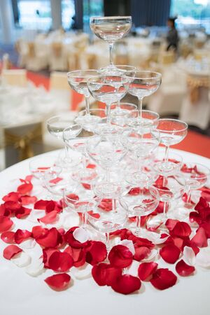 Pyramid of glasses of champagne in wedding ceremony