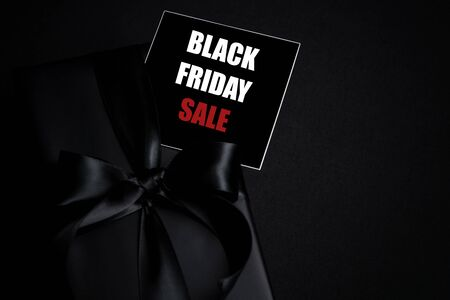 Top view of Black Friday Sale text with black gift box isolated on black background. Shopping concept boxing day and black Friday composition. Stock Photo - 134276455