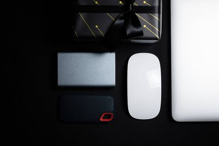 Cyber Monday Sale free space for text with mouse, laptop, hard dirve and gift box on black background. Shopping Online concept and Cyber Monday composition. Stock Photo - 134276469