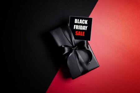 Top view of Black Friday Sale text with black gift box isolated on black background. Shopping concept boxing day and black Friday composition. Stock Photo - 134276470