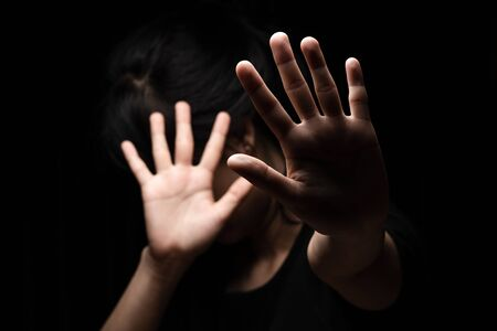 International Human Right day Concept: Women with her hand extended signaling to stop useful to campaign against violence, gender or discrimination