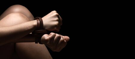 International Human Right day Concept: woman tied up with leather belt in emotional stress and pain Stock Photo - 138177114
