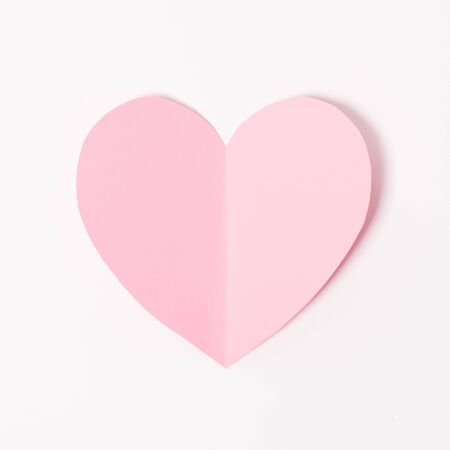 Paper elements in shape of heart flying on white paper background. Love and Valentine's day concept. Birthday greeting card design. Stock Photo - 139312945
