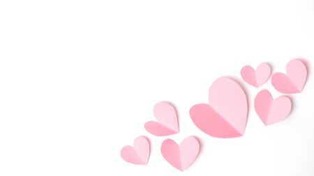 Paper elements in shape of heart flying on white paper background. Love and Valentine's day concept. Birthday greeting card design. Stock Photo - 139313053