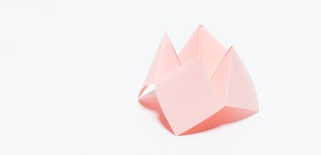 Paper fortune teller on white background Standard-Bild