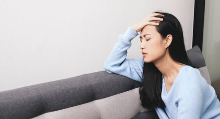 Panic attacks young girl sad fear stressful depressed emotional on the sofa. A person with anxiety, people with bad feeling down healthy.