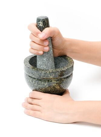 Granite mortar with woman hands on a white background