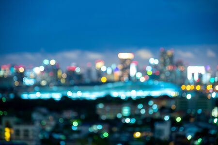 Blurred background of the night sky with the Bangkok city skyline