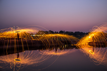 reflects: Glowing sparks Shower from spinning steel wool,with reflections