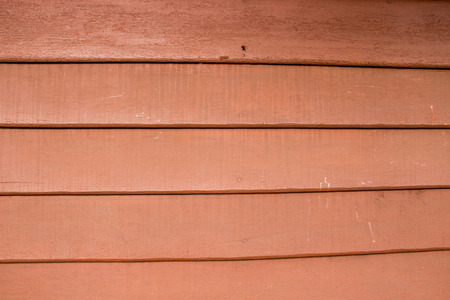 forefront: Red wood wall: texture  background