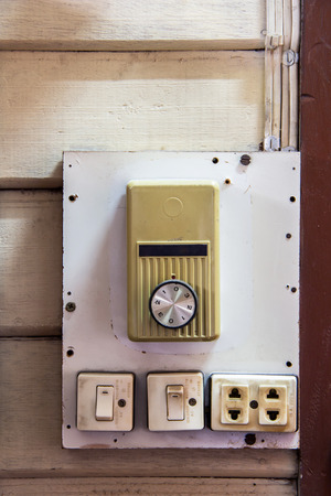 switch plug: Old switch and plug of ceiling fan and neon lamp on wooden wall