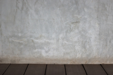 exposed concrete: Exposed concrete wall and wooden floor Stock Photo