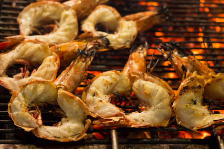 night market: Tiger Prawn barbecue on a gridiron over fire at the seafood night market