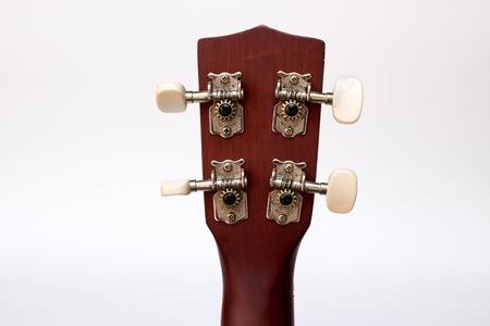 back of head: Detail closeup of back head ukulele Stock Photo