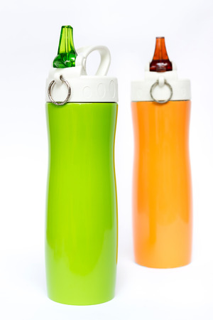 insulated drink container: Foreground on green and orange travel tumbler