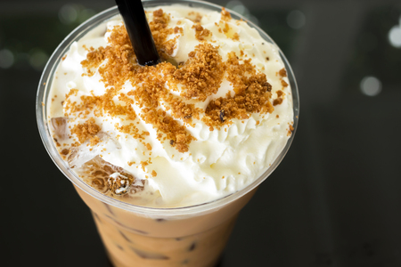 Ice caramel coffee with whipped cream in take a way cup