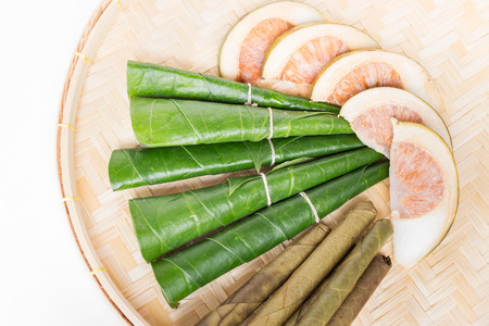 Areca nut, betel nut chewed with the leaf is mild stimulant on weave basket