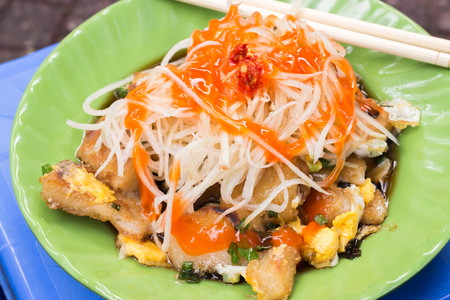 bot: Bot Chien Fried rice flour cake with eggs, Vietnamese street food in Ho Chi Minh city.