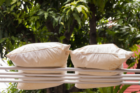 Leave pillows in the sun to plump it up again