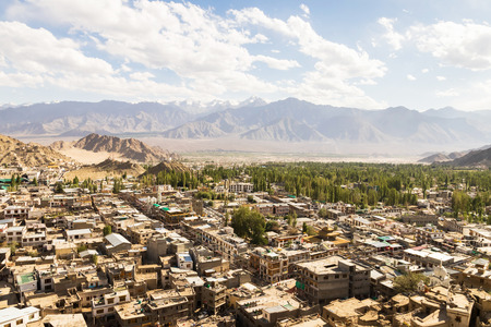 Old town of Leh city is located in the Indian Himalayas at an altitude of 3500 meters, high angle view from Leh palace in Leh Ladakh, Jammu and Kashmir, India.