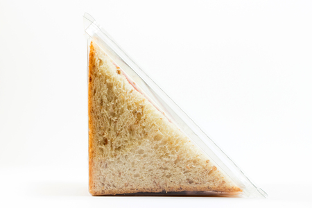 Whole wheat sandwich toast with ham and cheese in a plastic box isolated on white background Archivio Fotografico - 111325958