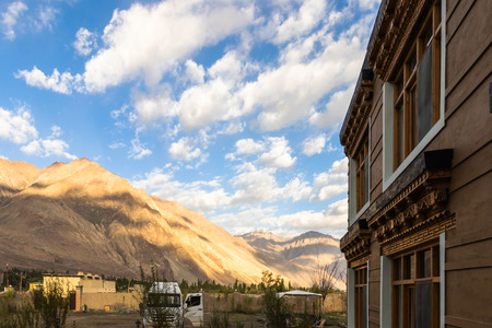 Beautiful mountain and blue sky with cloud view from tradition house in Nubra Valley, Ladakh, India.