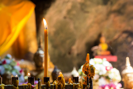 Candle light in a cave temple to worship buddha.