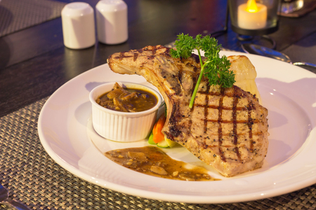 Grilled pork chop with mushroom sauce