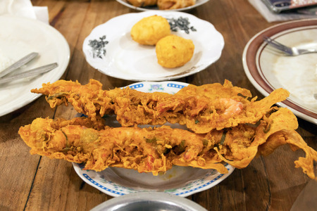 Warung Nasi Padang restaurant. Crunchy shrimp crisp and deep fried egg on the table one of the most famous meals to be associated with Indonesia, a mix of rice and side dishes. Stock Photo