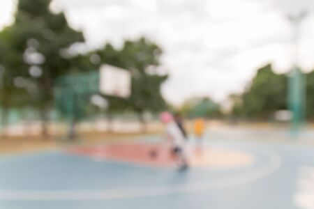Defocused and blurred image for background of basketball players on the basketball court